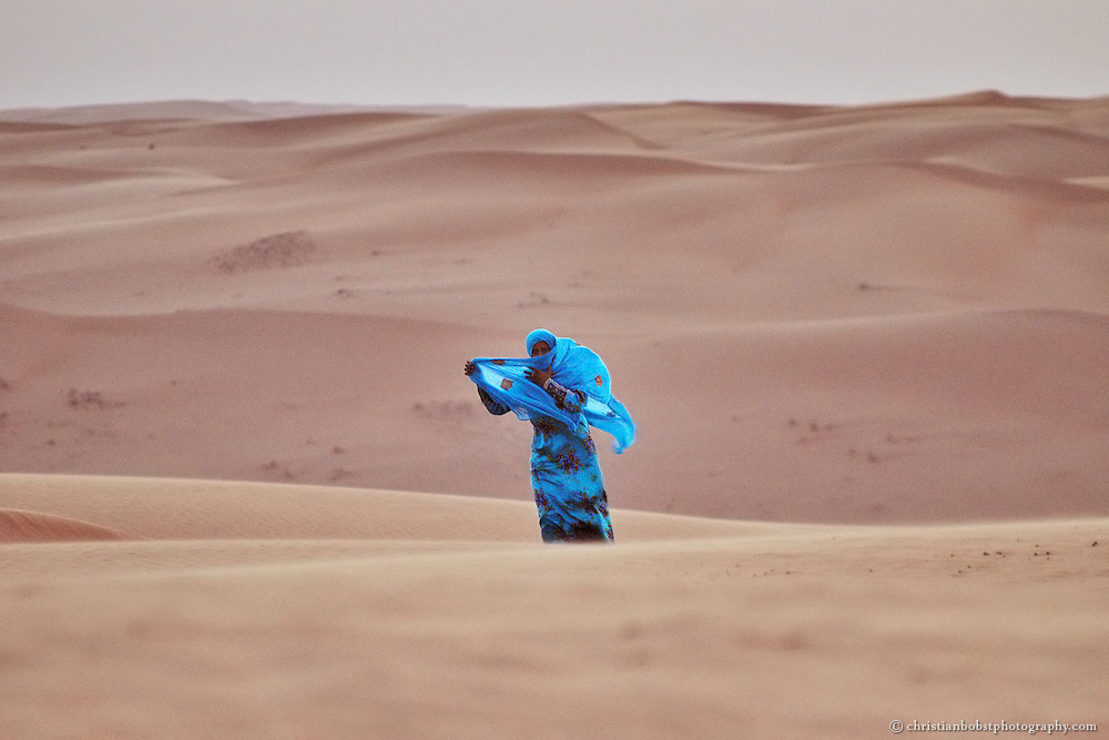 A beduin women returning from the dunes in Wahiba Sands, Oman, 2011