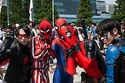 Cosplayers pose for a photograph during the Comic Market 90 (Comiket) event in Tokyo Big Sight on August 14, 2016, Tokyo, Japan. Many manga and anime fans wearing cosplay lined up in the sun for the third day of Comiket. Comiket was established in 1975 and focuses on manga, anime, gaming and cosplay. Organizers expect more than 500,000 visitors to attend this year's summer event which runs for three days until August 14.. 14/08/2016-Tokyo, JAPAN