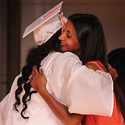 Red Lion Christian Academy senior class advisor Mrs. Letty Rupert hugs a students during commencement exercise Friday, May 29, 2015, at Glasgow Church in Bear, Delaware.