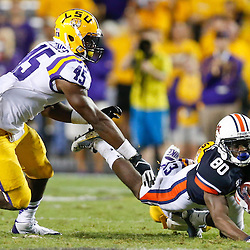 Sep 21, 2013; Baton Rouge, LA, USA; Auburn Tigers wide receiver Marcus Davis (80) dives forward for a first down against the LSU Tigers during the second half of a game at Tiger Stadium. LSU defeated Auburn 35-21. Mandatory Credit: Derick E. Hingle-USA TODAY Sports