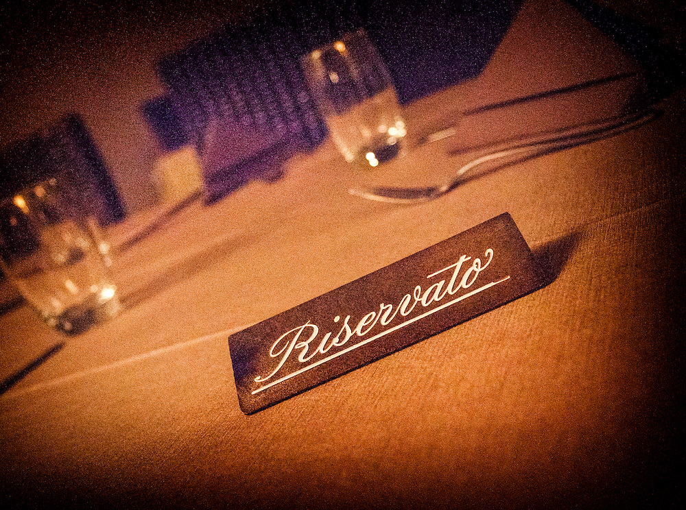 A reserved table in a restaurant in Chiavenna, Italy.