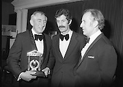 "Texaco Sportstars Of The Year Awards.1983..14.04.1983..04.14.1983..14th April 1983...Photograph of Ronnie Delaney being Congratulated by the Tanaiste,Mr Dick Spring and the Managing Director of Texaco Ireland,Mr Tony Hill,on his induction into the Sportstars ""Hall Of Fame""..Ronnie was a gold medal winner at the 1956 Summer Olympics in Melbourne,Australia. he triumphedin the 1500 metres event.."