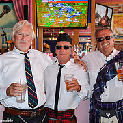 These sharply dressed gentleman stopped for a beer at the Pink Pony bar after a full day of making music with their bagpipes on Mackinac Island, Michigan.