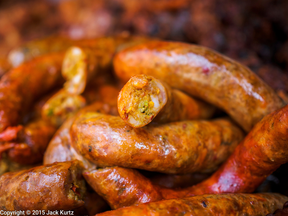 03 APRIL 2015 - CHIANG MAI, CHIANG MAI, THAILAND: Northern Thai sausage for sale in the market in Chiang Mai, Thailand. The sausage is made with pork and rice. It's flavored with onion, chilies and celery.      PHOTO BY JACK KURTZ