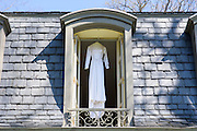 Annapolis, Maryland - April 18, 2015: Stephanie Cate's wedding dress was originally handmade by her great grandmother for Stephanie's grandmother. Stephanie is the third generation to wear the same dress. <br /> <br /> Stephanie Shearer Cate and Winston Bao Lord wed at their friends Jeff and Marry Zients' house in Annapolis, Maryland Saturday April 18, 2015. <br /> <br /> <br /> CREDIT: Matt Roth for The New York Times<br /> Assignment ID: 30173318A