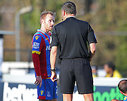 Crystal Palace Barry Bannan speaks with Referee Andre Marriner during the The FA Cup Third Round match between Dover Athletic and Crystal Palace at Crabble Athletic Ground, Dover, United Kingdom on 4 January 2015. Photo by Phil Duncan.