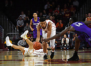 Nov 8, 2019; Los Angeles, CA, USA;  Southern California Trojans guard Charles O'Bannon Jr. (5) and Portland Pilots forward Tahirou Diabate (14) battle for the ball in the first half at Galen Center USC defeated Portland State 76-65.