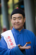 A watier welcomes visitors at the Lao She tea House in Beijing.
