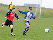 Padraic Daly Kiltullagh Pioneers chased  by Davey Mahon Kinvara FC in Kiltullagh, Galway. Photo:Andrew Downes