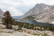 Hikers encounter a series of lakes as they climb up to Piute Pass, Inyo National Forest, CA.