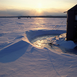 Chesuncook Lake, ME. Ice fishing shacks. Northern Forest.