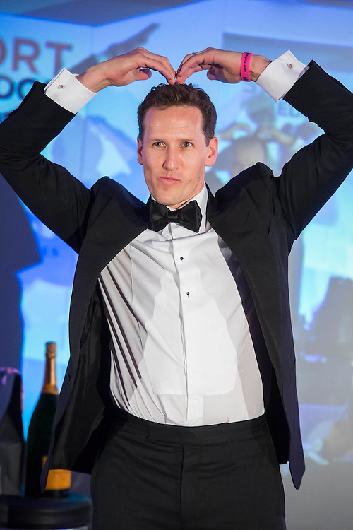 Brendan Cole,	 Stictly Come Dancing  does the Mobot as the runner up in the game of heads and tails - UK charity, Sport for Freedom (SFF), marks Anti-Slavery Day 2015 by hosting a charity Gala Dinner, supported by Aston Martin, on Thursday 15th October at Stamford Bridge, home of Chelsea Football Club. This inaugural event brought together people from the world of sport, entertainment, media, and business to unite behind a promise to tackle the issue of modern day human trafficking and slavery.  <br /> Hosted by Sky presenters Sarah-Jane Mee and Jim White, the Sport for Freedom Gala Dinner includes guests such as jockey AP McCoy OBE; Denise Lewis, former British Olympic Gold Medal winner; BBC Strictly star, Brendan Cole; Al Bangura, former Watford FC player and Sport for Freedom Ambassador who was trafficked from Africa to the UK at the age of just 14yrs old; Made in Chelsea star, Ollie Proudlock; ITV weather presenter, Lucy Verasamy; Sky Sports F1 presenter and SFF Ambassador, Natalie Pinkham; Premier League footballers Ryan Bertrand of Southampton FC and Troy Deeney of Watford FC and champion boxer, Anthony Joshua; and The UK's first independent Anti Slavery Commissioner, Kevin Hyland OBE, who highlighted the issues of modern day slavery that face the UK and world today. <br /> The evening concluded with chart topping music from 'Naughty Boy'. <br /> Sport for Freedom are also joining forces with the Premier League Academies for an international  'Football for Freedom' tournament with their U16's players that will also involve educating those taking part about the issues surrounding modern day slavery. The final will take place at Liverpool FC's Academy on Anti-Slavery Day, 18th October.