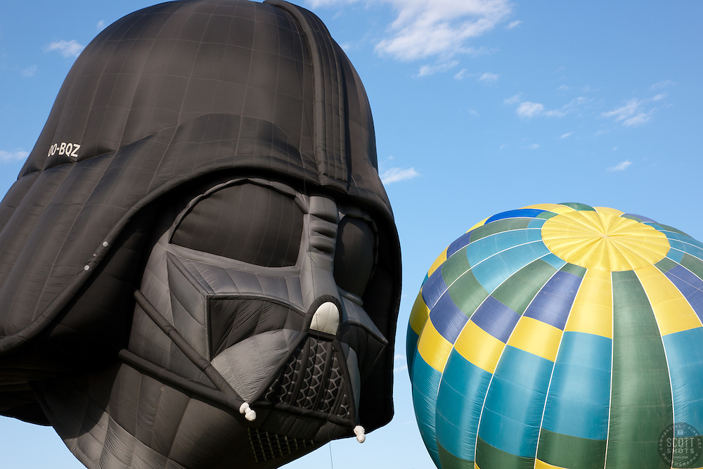 """""""Darth Vader and a Balloon"""" - This photo of the Darth Vader Balloon staring down a colorful balloon was photographed at the 2011 Great Reno Balloon Race."""