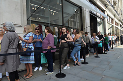 © Licensed to London News Pictures. 25/08/2017. London, UK. Customers queue outside for the opening of H&M group's first ARKET flagship store in Regent Street. ARKET has called itself a modern day market selling clothes, homeware as well as having a small cafe space. Photo credit: Ray Tang/LNP