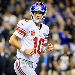 Nov 1, 2015; New Orleans, LA, USA; New York Giants quarterback Eli Manning (10) after throwing a touchdown to wide receiver Odell Beckham (not pictured) during the second quarter of a game against the New Orleans Saints at the Mercedes-Benz Superdome. Mandatory Credit: Derick E. Hingle-USA TODAY Sports