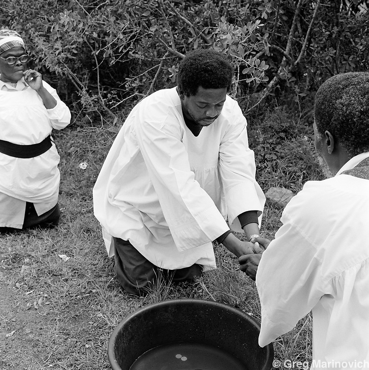 A cleansing ceremony prior to a wedding in northern KwaZulu Natal. The Nazareth Baptist Church, or Shembe, is a staunchly traditionalist Zulu cult that was founded in 1913 by Isiah Shembe after a vision. Their beliefs are a mix of Old and New Testament and the ancestral veneration of traditional Zulu culture. 1999