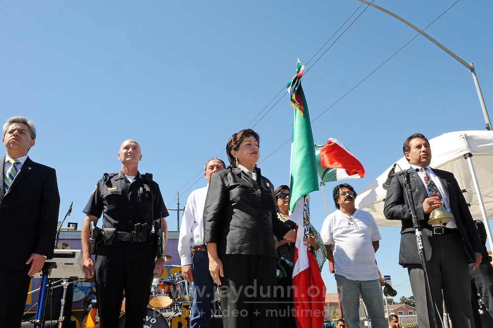 "Honorary consul Blanca Estela Zarazua guards the flag during the Mexican national anthem at Sunday's ""El Grito,"" or ""The Cry of Independence"" ceremony. From left, in front, are Carlos Ponce Martinez, consul general of Mexico in San Jose, Salinas police chief Kelly McMillin, and at right, Javier Aguilar Cuevas, attached consul, Mexican Consulate in San Jose."