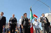 """Honorary consul Blanca Estela Zarazua guards the flag during the Mexican national anthem at Sunday's """"El Grito,"""" or """"The Cry of Independence"""" ceremony. From left, in front, are Carlos Ponce Martinez, consul general of Mexico in San Jose, Salinas police chief Kelly McMillin, and at right, Javier Aguilar Cuevas, attached consul, Mexican Consulate in San Jose."""