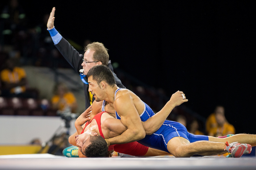 Juan Escobar (R) of Mexico looks up as the referee signals his win over Luis Avendano of Venezuela during their bronze medal bout in the 75kg class of the men's greco-roman wrestling at the 2015 Pan American Games in Toronto, Canada, July 15,  2015.  AFP PHOTO/GEOFF ROBINS