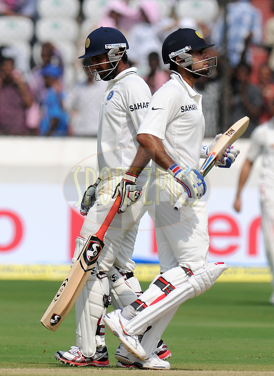 Cheteshwar Pujara of India and Virat Kholi of India run between the wicket  during day one of the first test match between India and New Zealand held at The Rajiv Gandhi International Stadium in Hyderabad, India on the 23rd August 2012..Photo by: Pal Pillai/BCCI/SPORTZPICS