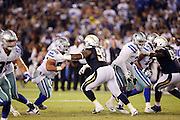 San Diego Chargers defensive tackle Darius Philon (93) works his way around a block by Dallas Cowboys center Shane McDermott (62) during the 2015 NFL preseason football game against the Dallas Cowboys on Thursday, Aug. 13, 2015 in San Diego. The Chargers won the game 17-7. (©Paul Anthony Spinelli)