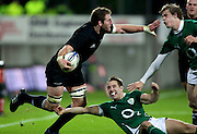 All Black Kieran Read tackled by Irelands  Tomas O'Leary, left and Andrew  Trimble during the New Zealand All Blacks v Ireland rugby   Internatioanl Test at Yarrow Stadium in New Plymouth, New Zealand. Saturday 12 June 2010.
