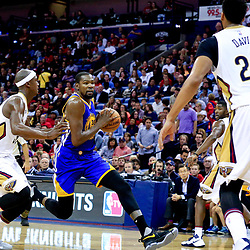 Oct 28, 2016; New Orleans, LA, USA;  Golden State Warriors forward Kevin Durant (35) drives past New Orleans Pelicans forward Dante Cunningham (33) during the second quarter of a game at the Smoothie King Center. Mandatory Credit: Derick E. Hingle-USA TODAY Sports