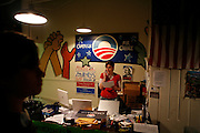 A volunteer works at Barack Obama's headquarters in Bloomington, Indiana while election results are posted.