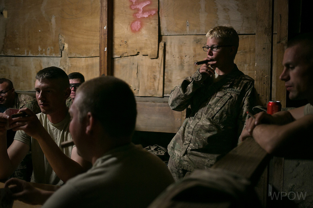 August 16, 2014 - Kjirsten Gray, a member the Wisconsin National Guard 829th Engineer Co., at cigar night with her company at Forward Operating Base Fenty in Jalalabad, Afghanistan. Gray is part of a group of engineers working to build up contractor housing at FOB Fenty as U.S. military combat operations in Afghanistan end. (photo by Meghan Dhaliwal)