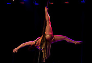 An aerial dancer spins during their act at Fire Ball X: Apocalypse at The Majestic Theater in Madison, Wisconsin., Saturday, Jan. 27, 2018.