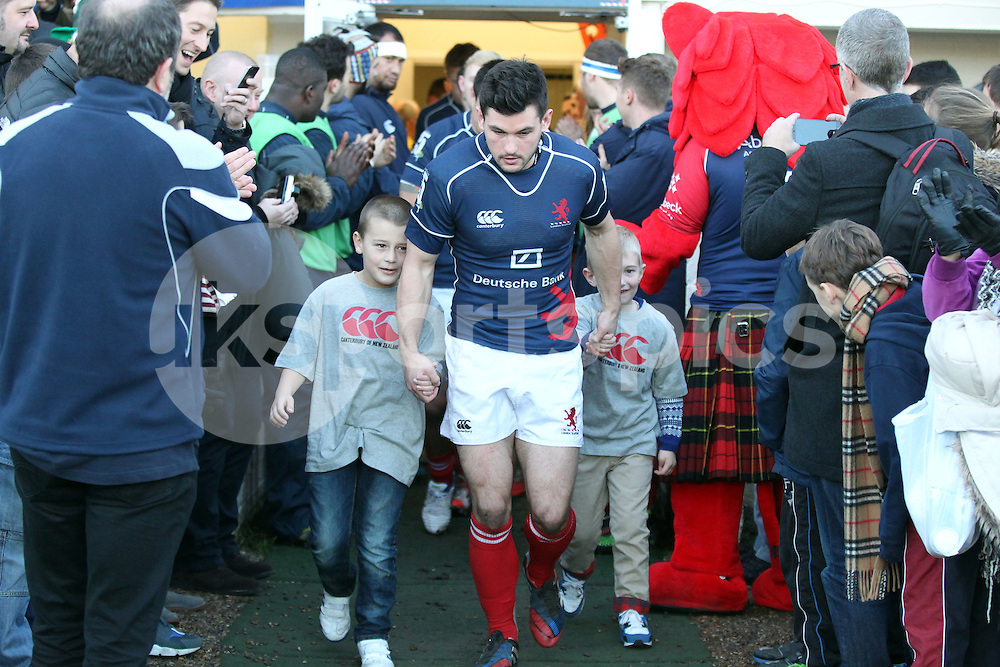 Captain Dan Newton leads out the team with the match mascots during the B&amp;I Cup match between London Scottish &amp; Pontypridd at Richmond, Greater London on 13th December 2014<br /> <br /> Photo: Ken Sparks | UK Sports Pics Ltd<br /> London Scottish v Pontypridd, B&amp;I Cup, 13th December 2014<br /> <br /> &copy; UK Sports Pics Ltd. FA Accredited. Football League Licence No:  FL14/15/P5700.Football Conference Licence No: PCONF 051/14 Tel +44(0)7968 045353. email ken@uksportspics.co.uk, 7 Leslie Park Road, East Croydon, Surrey CR0 6TN. Credit UK Sports Pics Ltd