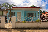 House and fence in Moron, Ciego de Avila, Cuba.