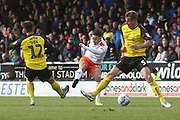 Luton Town forward Harry Cornick (14) shoots at goal during the EFL Sky Bet League 1 match between Burton Albion and Luton Town at the Pirelli Stadium, Burton upon Trent, England on 27 April 2019.