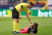 Spanish referee Xavier Estrada Fernandez with Atletic de Bilbao's Iker Muniain injured during La Liga match. May 21,2017. (ALTERPHOTOS/Acero)