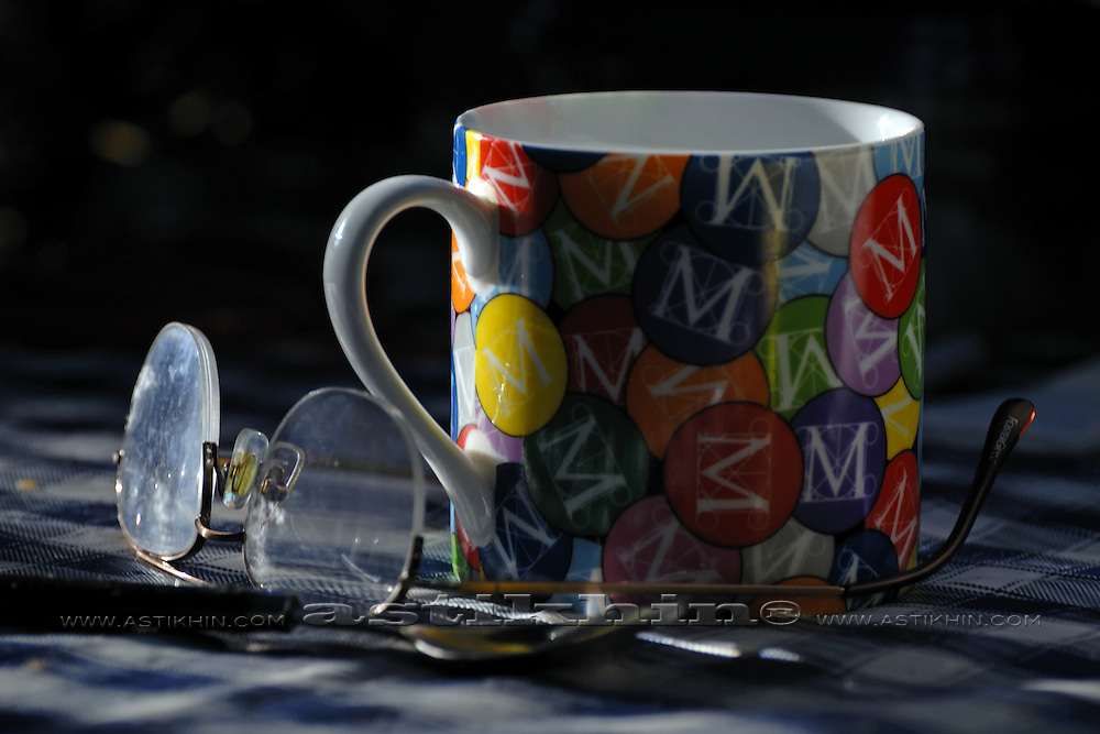 Coffee cup and glasses on table.
