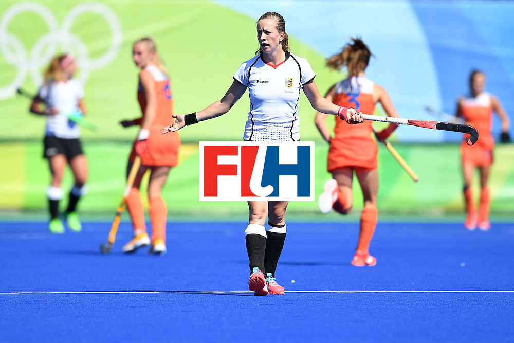 Germany's Franzisca Hauke reacts during the women's field hockey Netherlands vs Germany match of the Rio 2016 Olympics Games at the Olympic Hockey Centre in Rio de Janeiro on August, 13 2016. / AFP / MANAN VATSYAYANA        (Photo credit should read MANAN VATSYAYANA/AFP/Getty Images)