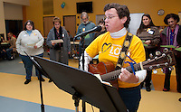 """Sarah Dan Jones sings Tikun Olam (Hebrew phrase for """"repairing the world"""")  joined by the audience during Laconia Middle School's Martin Luther King celebration Sunday evening.  (Karen Bobotas/for the Laconia Daily Sun)"""