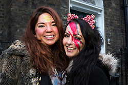 "© Licensed to London News Pictures. 17/01/2016. London, UK. Bowie fans and friends: Olivia Grist and Louise Gilmour queue for a public tribute event called ""Starman: A celebration of David Bowie"" at the Union Chapel in Highbury and Islington. The gig pays tribute and celebrates the life of David Bowie who died on 10 January 2016. Photo credit : Vickie Flores/LNP"