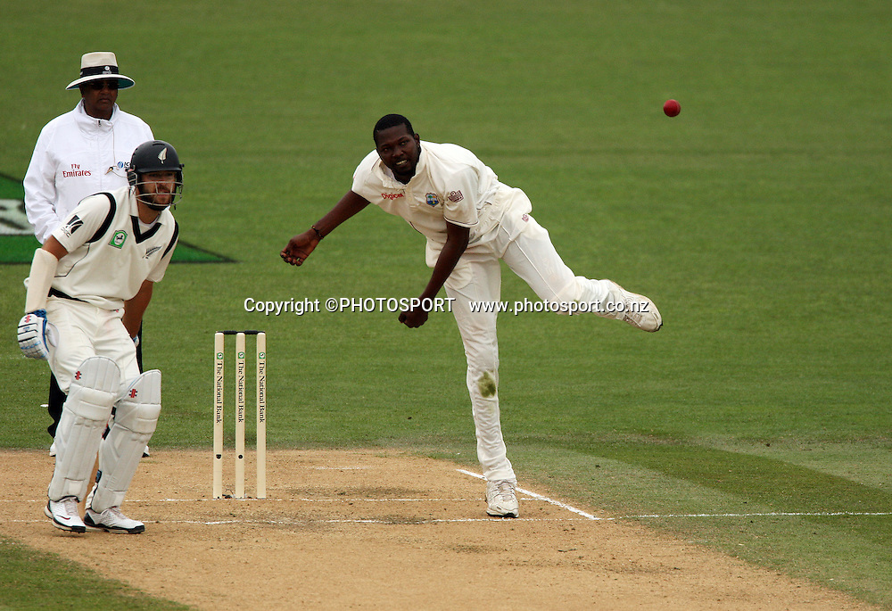 Sulieman Benn bowling as Daniel Vettori looks on during play on day 3 of the second cricket test at McLean Park in Napier. National Bank Test Series, New Zealand v West Indies, Sunday 21 December 2008. Photo: Andrew Cornaga/PHOTOSPORT