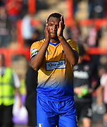 Krystian Pearce (5) of Mansfield Town applauds the fans after the 4-1 win over Exerter City at full time during the EFL Sky Bet League 2 match between Exeter City and Mansfield Town at St James' Park, Exeter, England on 30 March 2019.