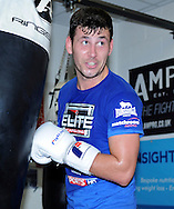 Picture by Alan Stanford/Focus Images Ltd +44 7915 056117<br /> 30/09/2013<br /> IBF World Middleweight Champion Darren Barker puts some work in on the punch bag during a media workout at Gator ABC, Hainault, Essex.
