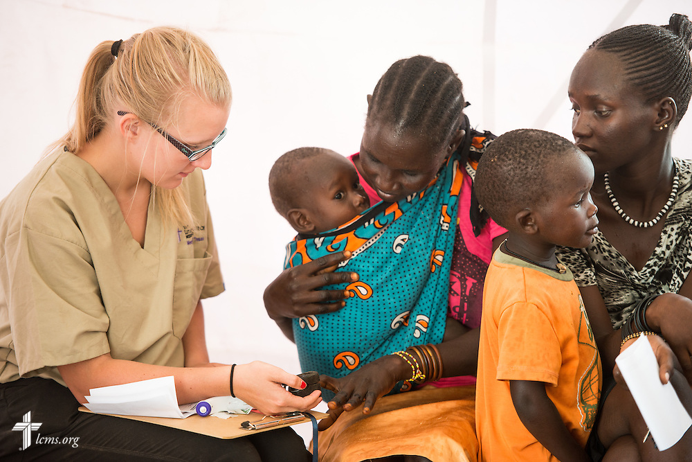 Sydney Kuempel, an incoming freshman nursing student from Guttenberg, Iowa, takes vitals from patients during the LCMS Mercy Medical Team on Tuesday, June 21, 2016, in Nataparkakono, a village in Turkana, Kenya.  LCMS Communications/Erik M. Lunsford