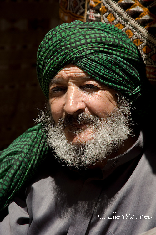 A man in a green turban in the souk in Marrakech, Morocco