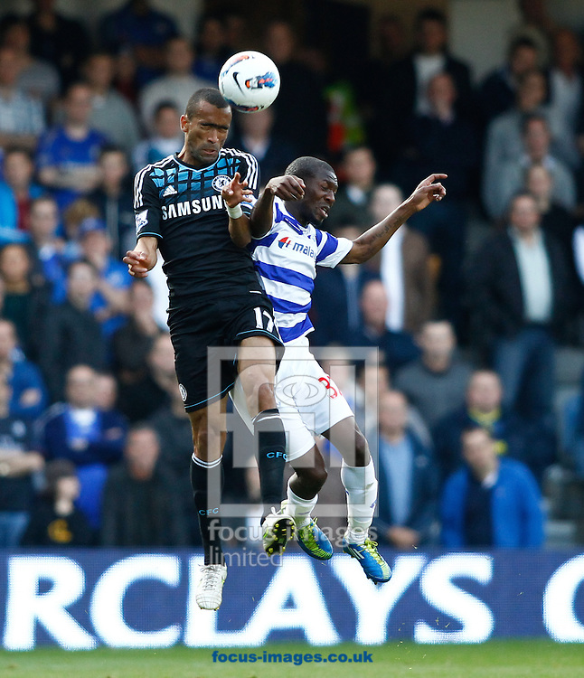 Picture by Andrew Tobin/Focus Images Ltd. 07710 761829. 23/10/11. Jose Bosingwa (17) of Chelsea is challenged by Shaun Wright-Phillips (32) of QPR during the Barclays Premier League match between QPR and Chelsea at Loftus Road, London.