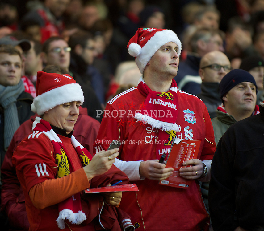 LIVERPOOL, ENGLAND - Saturday, December 10, 2011: Liverpool supporters in festive Santa hats during the Premiership match against Queens Park Rangers at Anfield. (Pic by David Rawcliffe/Propaganda)