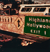 altered Polaroid photo of Hollywood exit sign, overpass and partial view of freeway