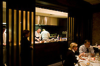 "9 December, 2008. New York, NY. Tom Collichio at Craft is ""on stage"" for customers in the open kitchen of Craft's dining room, a New York restaurant. Several restaurants offer special seatings with their celebrity chefs.<br /> <br /> ©2008 Gianni Cipriano for The New York Times<br /> cell. +1 646 465 2168 (USA)<br /> cell. +1 328 567 7923 (Italy)<br /> gianni@giannicipriano.com<br /> www.giannicipriano.com"