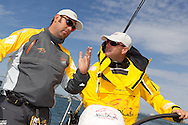 "ENGLAND, Cowes. 10th August 2011. Training with Abu Dhabi Ocean Racing. Wade ""Bubs"" Morgan, (left) talks with Ian Walker."