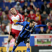 HARRISON, NEW JERSEY- November 06:  Aurelien Collin #78 of New York Red Bulls and Matteo Mancosu #21 of Montreal Impact challenge for the ball during the New York Red Bulls Vs Montreal Impact MLS playoff match at Red Bull Arena, Harrison, New Jersey on November 06, 2016 in Harrison, New Jersey. (Photo by Tim Clayton/Corbis via Getty Images)