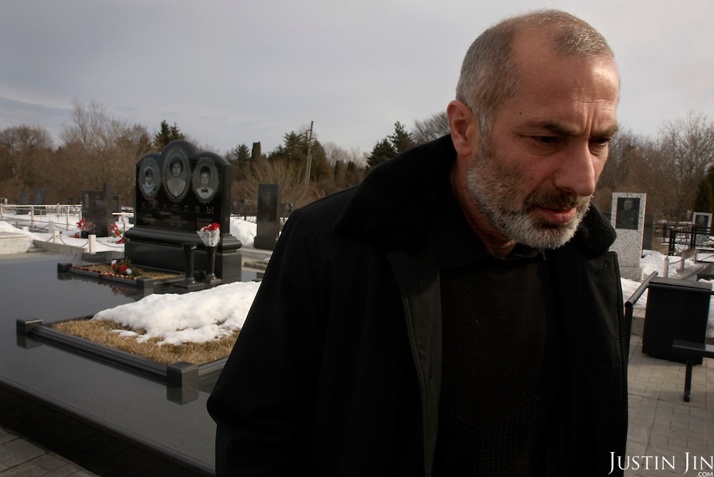 Vitali Kaloyev at the grave of his wife and children in Vladikavkaz, in North Ossetia in southern Russia. .The 52-year-old architect, who killed the air traffic controller blamed for the plane crash in which he lost his wife and two children, is being treated as a national hero..Kaloyev, who was freed November 2007 from a Swiss jail after serving less than four years, was appointed deputy construction minister for his home region..Kaloyev was building a holiday villa in Spain for a wealthy Russian when his wife Svetlana, 44, 10-year-old son Konstantin and four-year-old daughter Diana, set out to join him for a holiday in July 2002. As their plane flew over Germany it collided with a cargo jet killing all 71 people on board, most of them Russian schoolchildren..Investigators later established that Peter Nielsen, a Dane working for Skyguide, the Swiss air-traffic control service at Zurich airport, was the only person on duty. He had panicked when he realised the two planes were on a collision course and gave wrong instructions to the pilots..Like other bereaved relatives, Kaloyev grew angry at the slow pace of the investigation and the way Skyguide, fearful of lawsuits, sought to place the blame on others..Kaloyev claims he cannot remember what happened next, but does not deny stabbing Nielsen several times with a pocket knife. Nielsen bled to death before an ambulance could reach him. Kaloyev was arrested the following day and was sentenced to eight years for manslaughter.